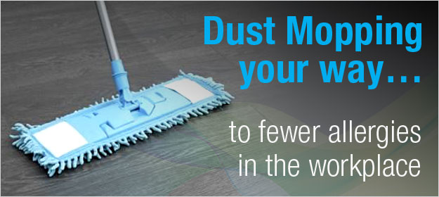 A dust mop sweeps the floor trying to reduce the amount of allergies in the workplace
